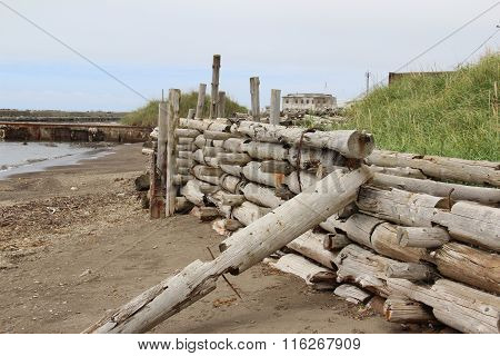 wooden pier, enclosing the shore from the storm