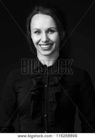 Woman  In Black Shirt With Bright Lipstick And Broad Smile