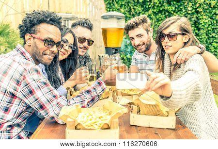 Friends Taking Selfie In A Restaurant