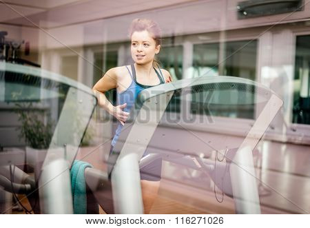 Woman Running In A Gym