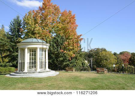 White Gazebo And Park Benches In Autumn