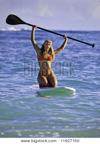 girl on a stand up paddle board
