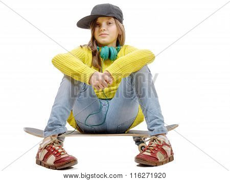 Pretty Young Girl Posing With A Skateboard, Sitting On Skate, On White