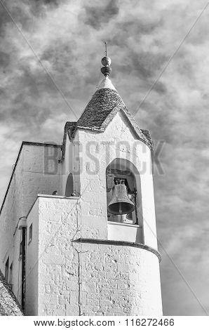 Belltower Of The Trullo Church In Alberobello, Italy