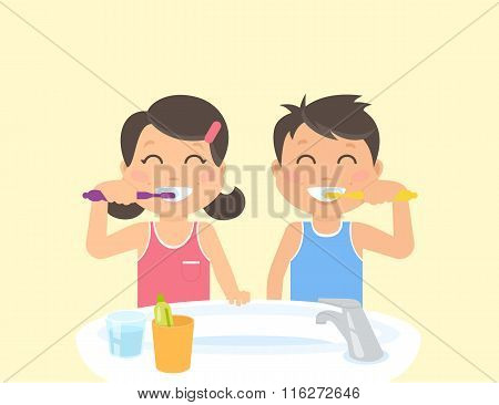 Happy kids brushing teeth standing in the bathroom near sink