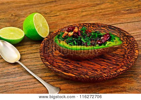 Avocado salad with herbs dill, parsley, cilantro, nuts and sun