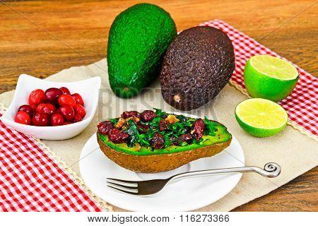 Avocado salad with herbs dill, parsley, cilantro, nuts