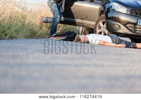 Boy Hit By A Vehicle Lying On The Road Wounded