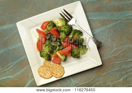 Plate full of fresh veggies.