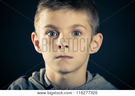 Boy With Wide Open Eyes Staring At The Camera