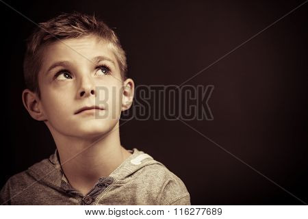 Serious Young Boy Sitting Thinking