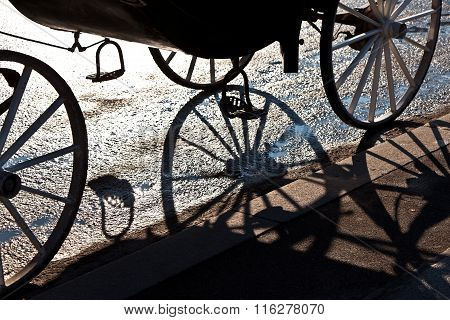 detail of fiaker wheel with shadow in Vienna