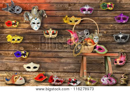 Carnival Masks Hanging On  Wall Boards Lie On Floor And  Bench In A Wicker Basket
