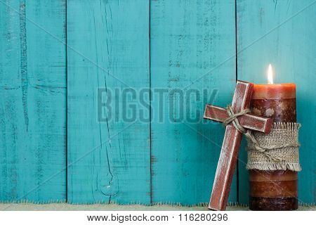 Wood cross by candlelight