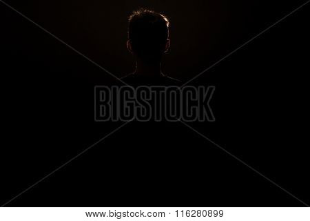 Silhouette Of Standing Young Boy With Copy Space
