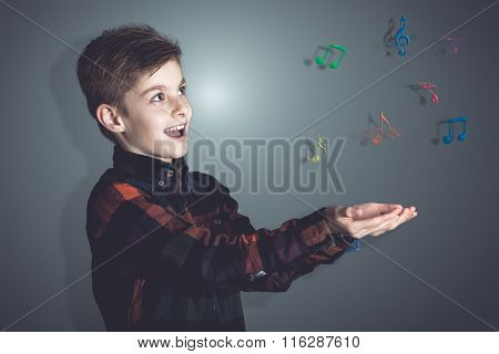 Colored Musical Notes Over The Hands Of A Boy