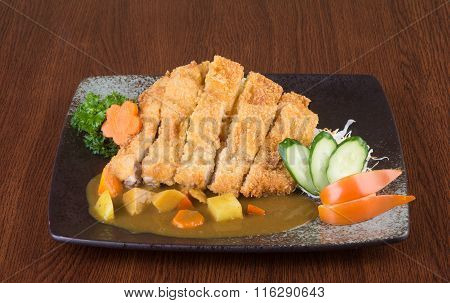 Japanese Cuisine. Fried Chicken Curry On The Background