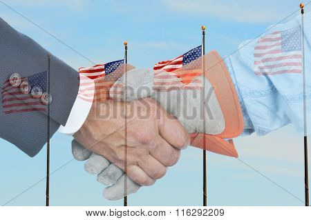 Two hands one businessman in suit and gloved workers hand double exposed over blue sky with American Flags. Management and Labor handshake.