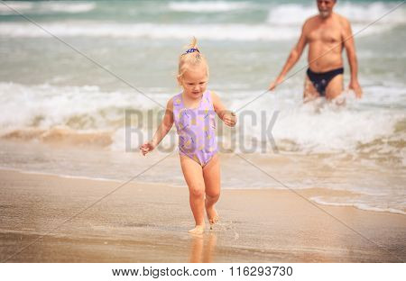 Grandpa Blond Girl With Pigtail Stand In Foamy Wave Surf