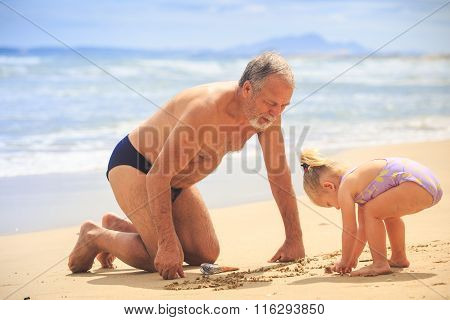 Grandpa Little Blond Girl Draw On Wet Sand Beach By Surf