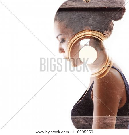 Double exposure portrait of beautiful woman and vintage photo camera. Beauty portrait of young mulatto woman in profile with retro photograph camera over white.