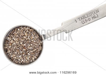 chia seed on metal measuring tablespoon, isolated on white