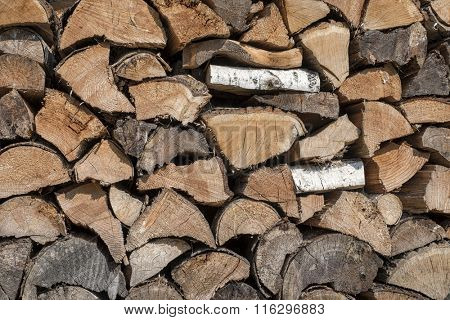 Stack of neatly arranged firewood ready for the winter