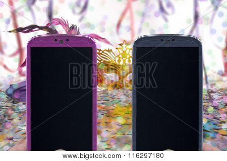 Carnival chatting and messaging - Female and male smartphones on Carnival background