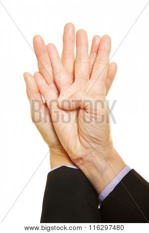 Elderly woman showing two hands with spread fingers