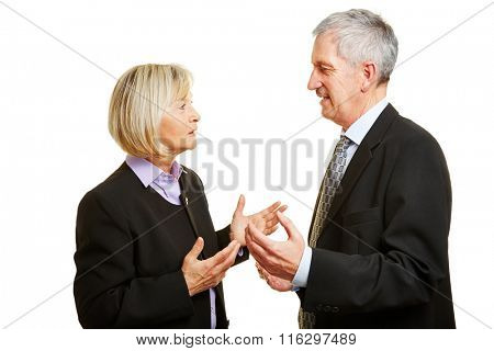 Two old businesspeople talking and argueing in a discussion