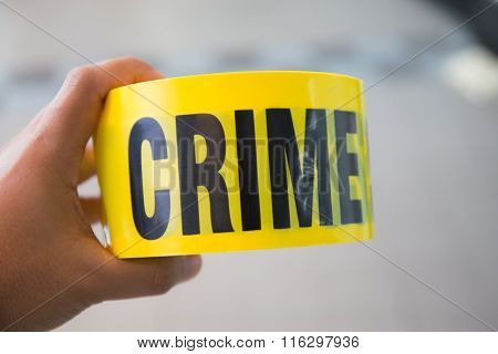 Hand Hold Yellow Crime Scene Tape