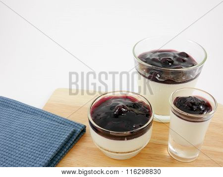 The tasty homemade blueberry panna cotta (Italian pudding dessert) in the small glass