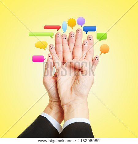 Social Media Chat with many smileys on fingers of two hands