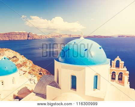 White Architecture and Blue Ocean, Santorini Island, Greece, View of caldera with domes at sunset