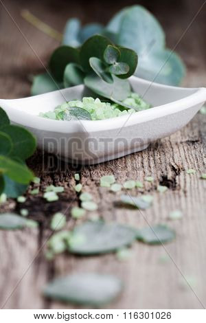Green bath salt with fresh eucalyptus leaves