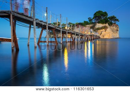 Hanging bridge to the island at night, Zakynthos in Greece