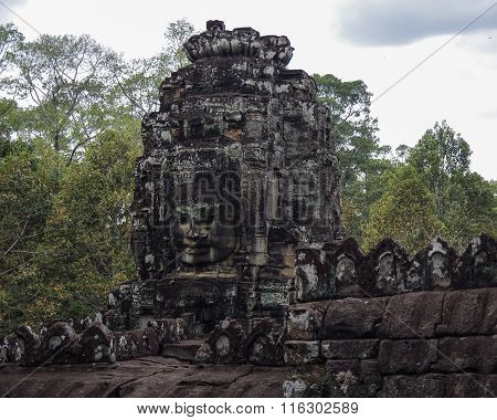 Face Stone Of Ancient Bayon Temple In Angkor Wat, Siem Reap, Cambodia