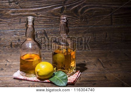 Two Bottles Whiskey With Lemon Are On The Napkin