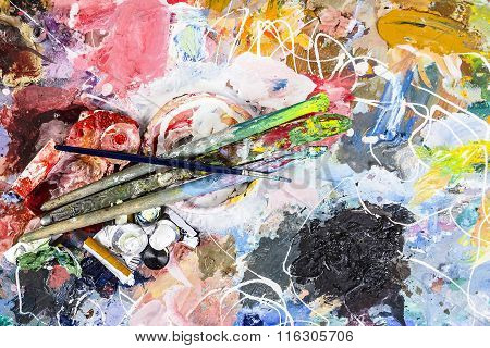 Artist Palette With A Cup For Mixing Oil Paints And Brushes With  Knife