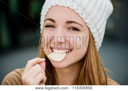 Teenager eating  chips