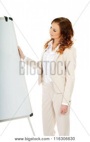 Business woman near flipchart.