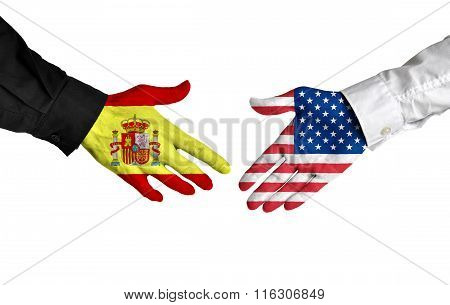 Spain and United States leaders shaking hands on a deal agreement