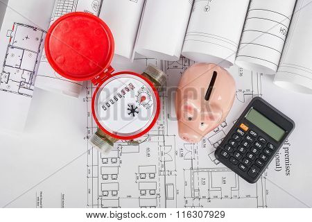 Water meter with calculator on blueprint