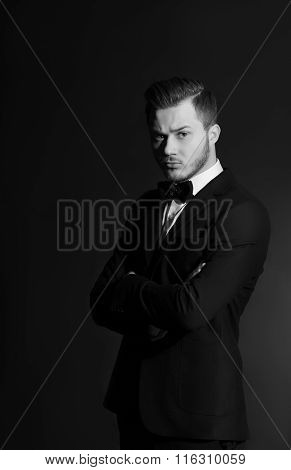 Handsome stylish young man. Brutal man with a beard