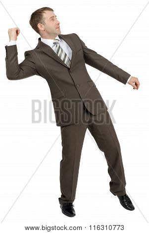 Businessman throwing invisible thing