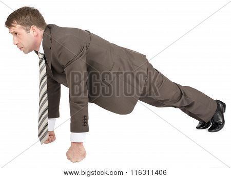 Businessman doing push-ups on fists