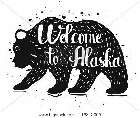 Handlettering A Vintage Poster Of Alaska. Isolated Silhouette Of A Bear With Text On A White Backgro