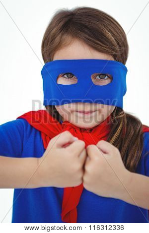Masked girl pretending to be superhero showing fist-to-fist on white screen