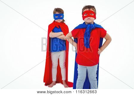 Masked kids pretending to be superheroes on white screen