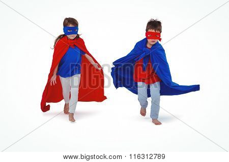 Masked kids running pretending to be superheroes on white screen
